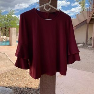 Tops - Deep red bell sleeve top with zipper detail